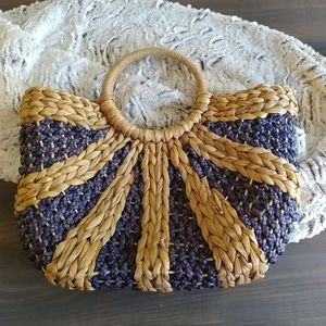 Navy and tan basket weave hand bag